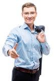 Homme d'affaires réussi heureux étirant sa main pour une poignée de main Photo libre de droits