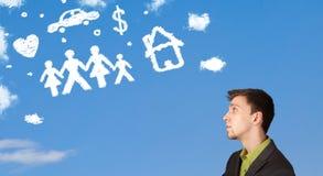 Homme d'affaires rêvassant avec des nuages de famille et de ménage Photos libres de droits