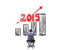 Homme d'affaires regardant le succès avec le concept de bénéfice pendant l'année 2015 Photos stock