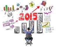 Homme d'affaires regardant le succès avec le concept de bénéfice pendant l'année 2015 Image libre de droits