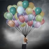 Homme d'affaires retenant des ballons Images libres de droits