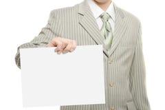 Homme d'affaires retenant la page du papier blanche Photo stock