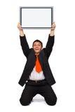 Homme d'affaires retenant le panneau vide Image stock