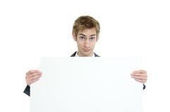 Homme d'affaires retenant le signe blanc Photographie stock