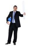 Homme d'affaires retenant un casque Images stock