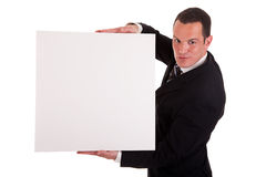 Homme d'affaires retenant un panneau blanc Images libres de droits