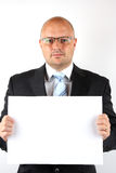 Homme d'affaires retenant un signe blanc images stock
