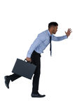 Homme d'affaires Running With Briefcase image stock