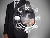 Homme d'affaires sélectionnant un hologramme Images libres de droits