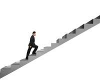 Homme d'affaires s'élevant sur l'escalier concret d'isolement dans le blanc Photographie stock libre de droits