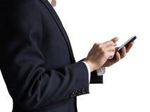 Homme d'affaires sûr dans le costume utilisant le smartphone, d'isolement sur le fond blanc Photos stock