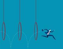 Homme d'affaires sautant par des cercles Photographie stock libre de droits