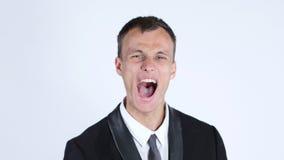 Homme d'affaires Screaming, fond blanc Photographie stock libre de droits