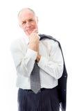 Homme d'affaires se tenant avec la main sur le menton Images stock