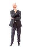 Homme d'affaires se tenant avec la main sur le menton Image stock