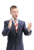 Homme d'affaires se vantant de la taille de quelque chose Photographie stock libre de droits