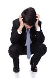 Homme d'affaires semblant déprimé du travail Photo stock