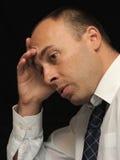 Homme d'affaires semblant triste photos stock