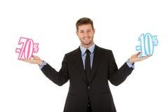 Homme d'affaires, signe d'escompte de soixante-dix vingt pour cent Image libre de droits