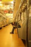Homme d'affaires Sleeping sur le souterrain photographie stock