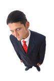 Homme d'affaires soupçonneux et drôle Photographie stock libre de droits