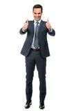Homme d'affaires souriant avec des pouces  Images libres de droits