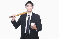 Homme d'affaires souriant avec la batte et le base-ball Photos stock