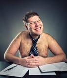 Homme d'affaires souriant d'un air affecté Photo libre de droits