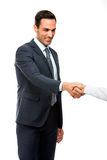 Homme d'affaires souriant et serrant la main Photographie stock