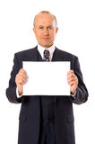 Homme d'affaires souriant retenant votre message Photographie stock