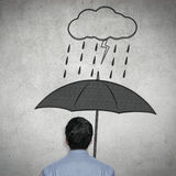 Homme d'affaires sous le parapluie Images libres de droits
