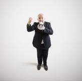 Homme d'affaires supérieur criard Photographie stock