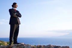 Homme d'affaires sur la côte Photos stock