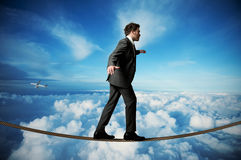 Homme d'affaires sur la corde Image stock