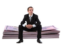 Homme d'affaires sur la pile du dollar Photos libres de droits