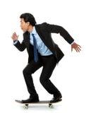 Homme d'affaires sur la planche à roulettes Photos libres de droits