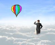 Homme d'affaires sur le baloon d'air Photographie stock