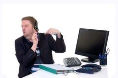 Homme d'affaires sur le bureau image stock