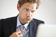 Homme d'affaires surchargé Image stock