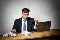 Homme d'affaires surchargé Photo stock