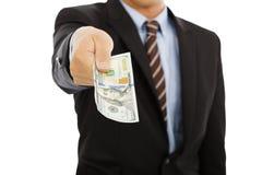 Homme d'affaires tenant argent de dollar US D'isolement sur le blanc Photos libres de droits