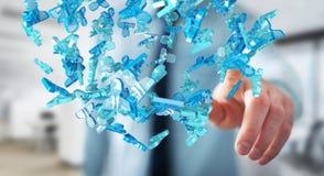 Homme d'affaires tenant 3D rendant le groupe de personnes bleues Photos stock