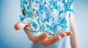 Homme d'affaires tenant 3D rendant le groupe de personnes bleues Photographie stock