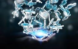 Homme d'affaires tenant 3D rendant le groupe de personnes bleues Image stock