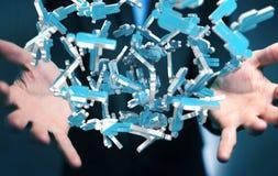 Homme d'affaires tenant 3D rendant le groupe de personnes bleues Photographie stock libre de droits