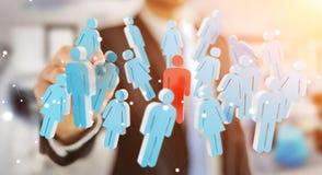 Homme d'affaires tenant 3D rendant le groupe de personnes dans sa main Photos libres de droits
