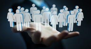 Homme d'affaires tenant 3D rendant le groupe de personnes dans sa main Photo libre de droits