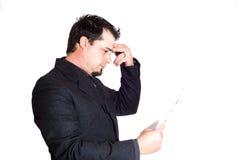 Homme d'affaires tenant des écritures Images stock