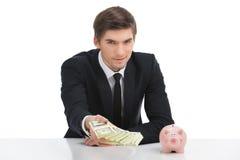 Homme d'affaires tenant des billets d'un dollar, d'isolement sur le blanc Photographie stock
