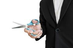 Homme d'affaires tenant des ciseaux, foyer sélectif, d'isolement sur le fond blanc Photographie stock